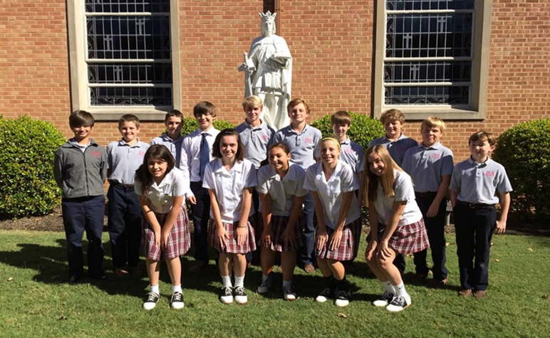 Cardinal Post October 2015: students in front of the school before heading out to the Duke TIP Program