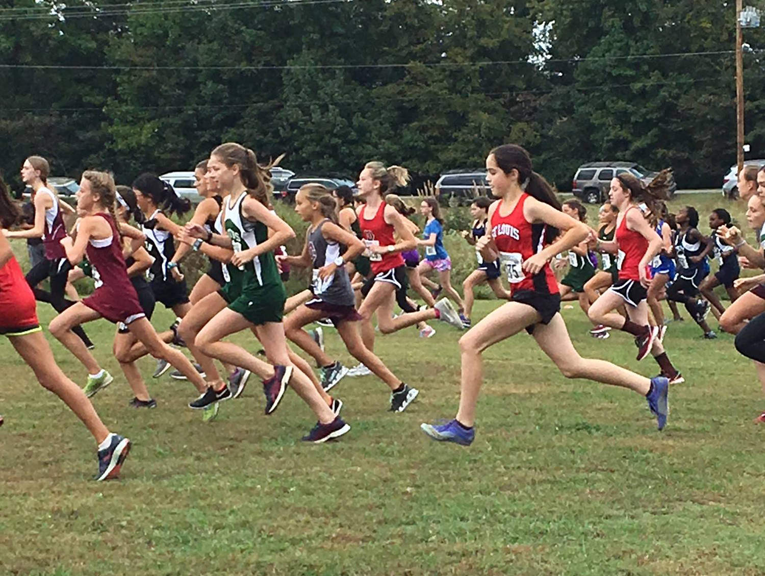 Cardinal Post: Girls Cross Country runners at Shelby Farms during a meet. Athletics Memphis Catholic School