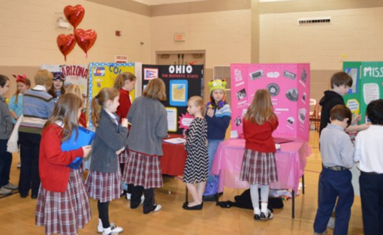 Cardinal Post Feb - Mar 2014: Students learning about the different States at the State Fair hosted by the fourth graders