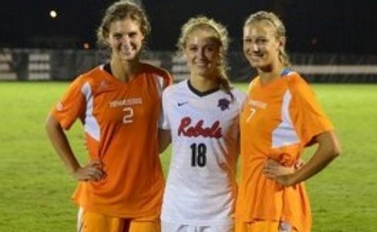 Cardinal Appeal: SLS Grads smiling after a college soccer match