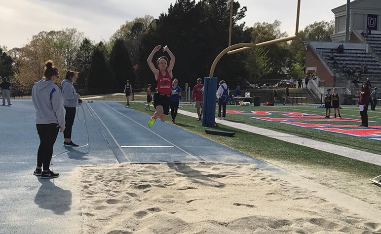 Cardinal Appeal: SLS Track & Field sports athlete competing in the long jump event.