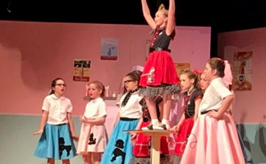"Cardinal Appeal SLS Achievements: Girls Performing in the SLS 2018 Spring Musical ""Rockin Around the Block"". St. Louis Memphis Catholic school extracurricular"