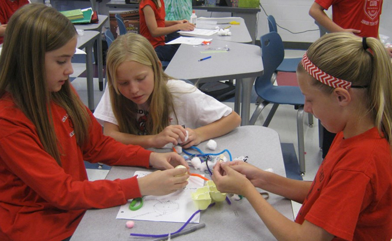 Cardinal Post October 2014: Students learning the importance of wearing a helmet through activities.